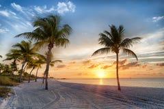 Salida del sol en la playa de Smathers Imagen de archivo libre de regalías