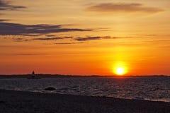 Salida del sol en la punta de Oriente Imagenes de archivo