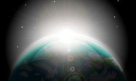 Salida del sol en la tierra del espacio Foto de archivo