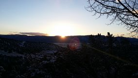 Salida del sol en las montañas Imagen de archivo libre de regalías