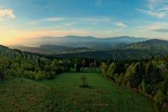 Salida del sol en montaña Fotografía de archivo libre de regalías