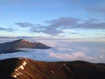 Salida del sol en montañas Imagen de archivo libre de regalías