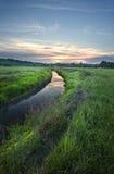 Salida del sol en el río Fotos de archivo libres de regalías