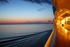 Salida del sol en un barco de la travesía Foto de archivo libre de regalías