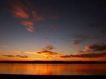 Salida del sol en un lago Fotos de archivo