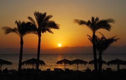 Salida del sol en una playa Fotografía de archivo