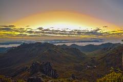 Salida del sol entre las nubes Imágenes de archivo libres de regalías