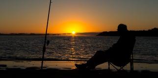 Salida del sol Fishing_.dng Imagen de archivo libre de regalías