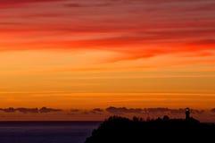 Salida del sol hermosa de Sydney sobre un faro foto de archivo