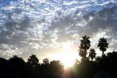 Salida del sol nublada Imágenes de archivo libres de regalías