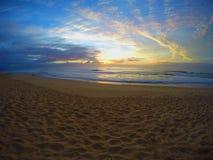 Salida del sol nublada de la playa Imagen de archivo libre de regalías