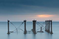 Salida del sol nublada en el faro de Mahon del puerto Fotografía de archivo libre de regalías
