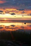 Salida del sol nublada en el mar imagen de archivo libre de regalías