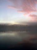 Salida del sol por el lago Imagenes de archivo