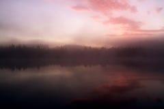 Salida del sol por el lago Imágenes de archivo libres de regalías
