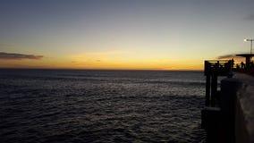 Salida del sol por el mar Imágenes de archivo libres de regalías