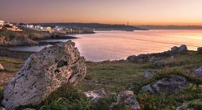 Salida del sol por el mar en Santa Maria di Leuca Foto de archivo libre de regalías