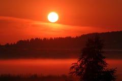 Salida del sol roja Fotografía de archivo