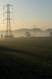 Salida del sol sobre campo del pilón Imagen de archivo libre de regalías