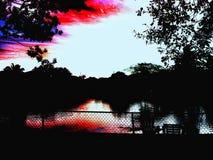 Salida del sol sobre el agua Foto de archivo libre de regalías