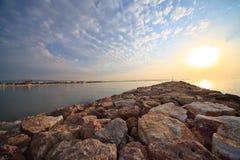 Salida del sol sobre el embarcadero Fotos de archivo libres de regalías