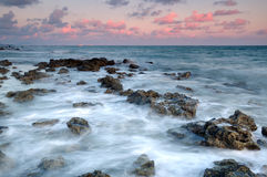 Salida del sol sobre el mar Fotos de archivo