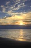 Salida del sol sobre el mar, Bibione, Italia Foto de archivo libre de regalías