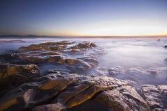 Salida del sol sobre el océano Fotos de archivo