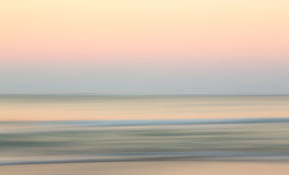 Salida del sol sobre el océano con la cacerola oblicua Fotografía de archivo libre de regalías