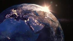 Salida del sol sobre la opinión de la tierra del espacio