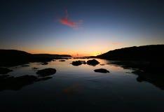 Salida del sol sobre la punta Devon del comienzo Imagen de archivo