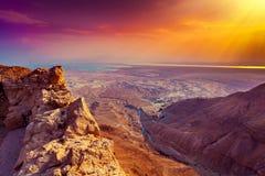 Salida del sol sobre los fortres de Masada Imagen de archivo libre de regalías