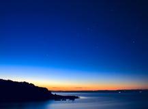 Salida del sol y estrellas Imagen de archivo libre de regalías