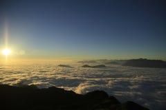 Salida del sol y nubes Foto de archivo libre de regalías