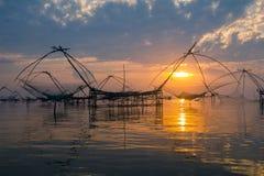 Salida del sol y pescador Fotos de archivo libres de regalías