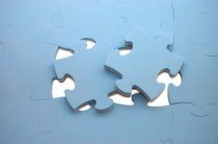 Salida parte de un rompecabezas azul Imagen de archivo