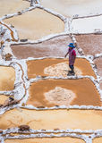 SALINAS DE MARAS, PERU - OCTOBER 12, 2015: Workers extracting sa Stock Photos