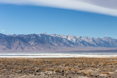 Saline Owens lake with Sierra Nevada mountains Stock Images