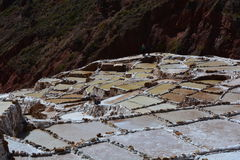 Salineras de Mara salt fields in Cusco, Peru. The Salineras de Mara is a salt field used to obtain salt from the water that comes from the Andes Mountain Range Stock Photos