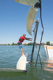 Salior trying to right catamaran after capsize. Salior trying to right his catamaran after capsize stock photography