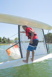 Salior trying to right catamaran after capsize. Salior trying to right his catamaran after capsize stock photo