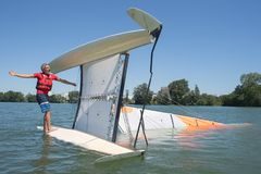 Salior trying to right catamaran after capsize. Salior trying to right his catamaran after capsize royalty free stock photo