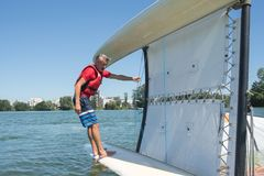 Salior trying to right catamaran after capsize. Salior trying to right his catamaran after capsize stock images