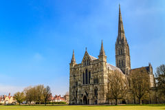 Salisbury Cathedral. Front view and park on sunny day, South England Stock Image