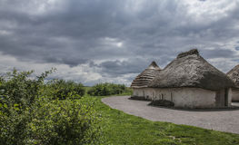 Salisbury plain - thatched houses and cloudy skies. Royalty Free Stock Photography