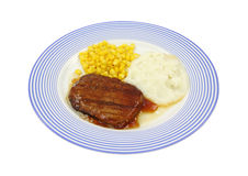 Salisbury steak dinner on blue plate Royalty Free Stock Photos
