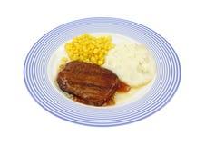 Salisbury steak dinner on blue plate Royalty Free Stock Photos