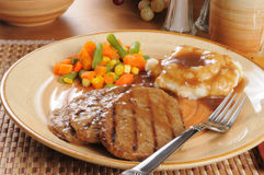 Salisbury steak dinner with mixed vegetables Stock Photos