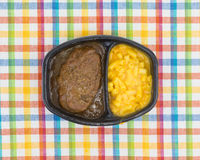 Salisbury steak meal with macaroni and cheese TV dinner royalty free stock photo