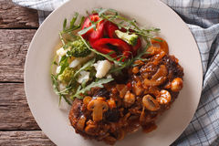 Salisbury steak with mushroom sauce and vegetable close-up. hori Royalty Free Stock Image